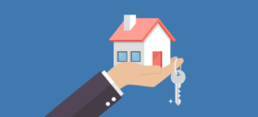 Man holding a house with keys